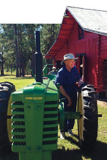 Dr. Roy Witherington on a farm