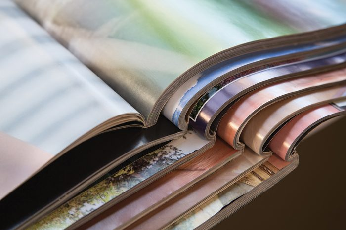 Close-up of stack of colorful magazines. Photo by Bigstock.