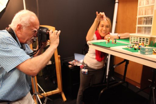 Phil Jones and Tricia Perea set scenes in the photo studio.