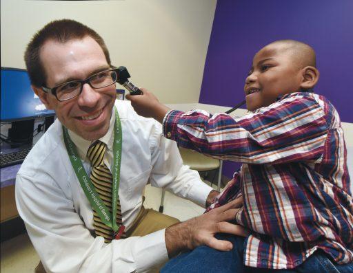 Dr. J. Drew Prosser with Harold Henderson III