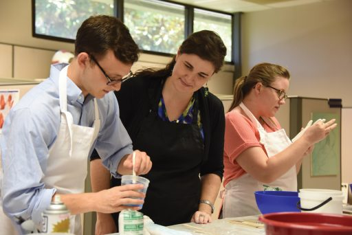 Amanda Behr (center) teaches a class.
