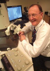 Dr. Pashley at desk