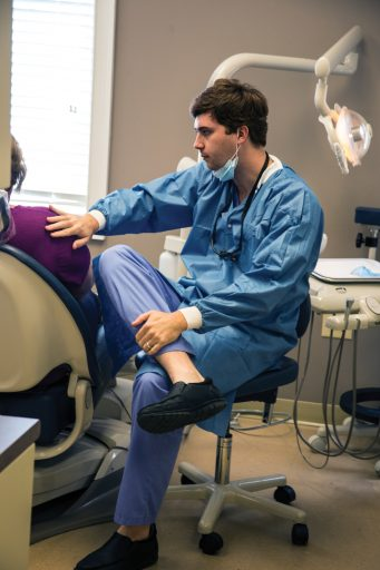 Dr. Grayson Griffis ('15) is among those providing treatment at the Lloyd Darby Compassionate Care Dental Clinic.