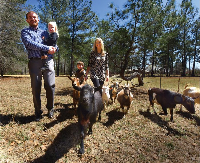 Billy, Blakely, Bentley and Mandi Brinson walk the goats. Photo by Phil Jones.