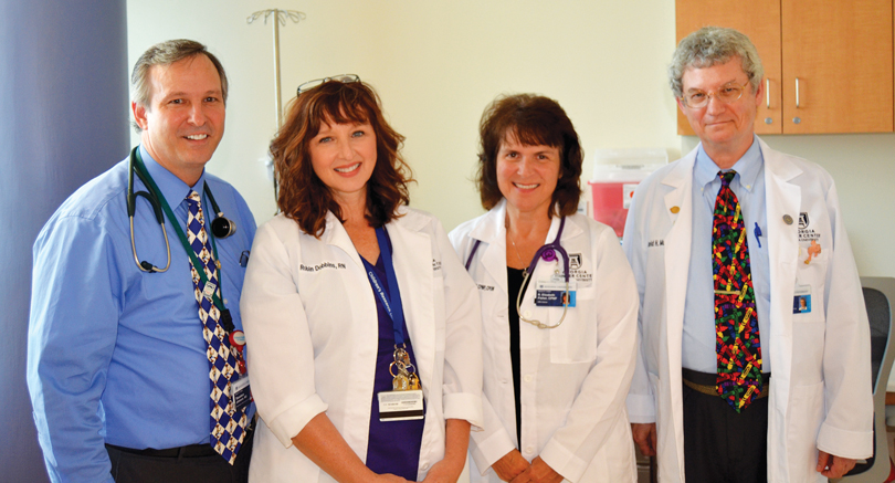 Drs. Johnson and David Munn with pediatric nurse practitioners Robin Dobbins and Beth Fisher