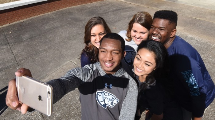 Students wear clothes with the new Augusta University brand