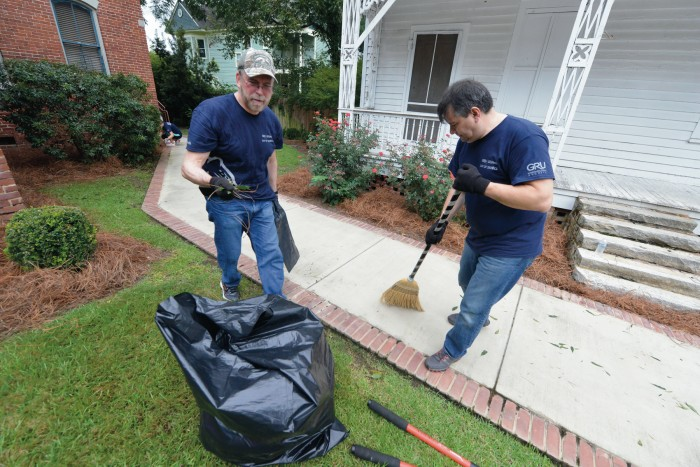 Vice Dean Kevin Frazier does yard work at the Christ Community Health Center.