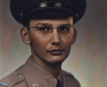 The solemn little boy grew up to be a slim, serious teenager sportinground glassesand a neatly combed hairstyle, part of the class of '44 at the new Gray High School.