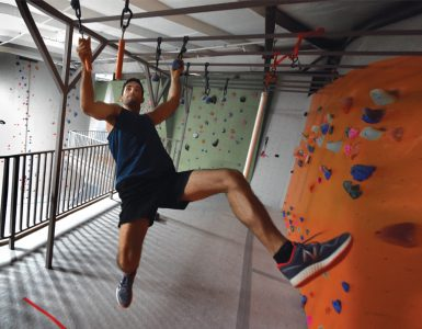 Jackson Griffeth scales ninja obstacles at Active Climbing Augusta. Photo by Phil Jones.