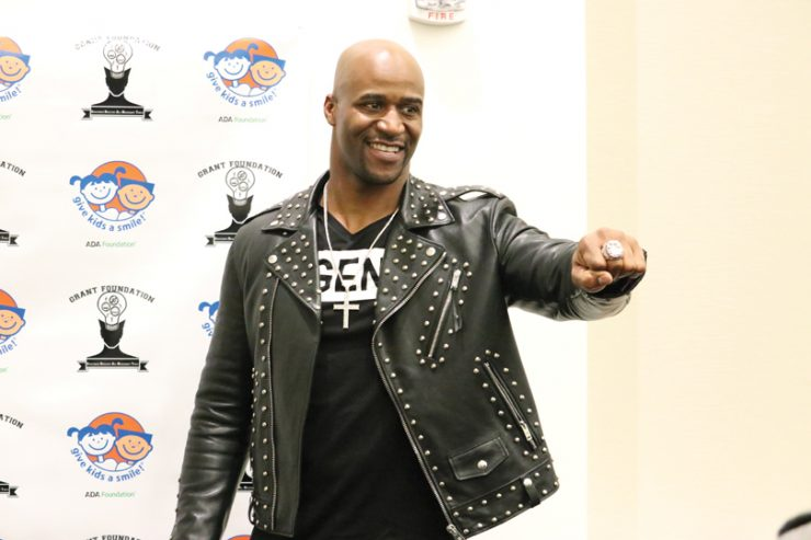 Deon Grant delivers an oral health and anti-bullying message during Give Kids a Smile Day. Photos by Carl A'see