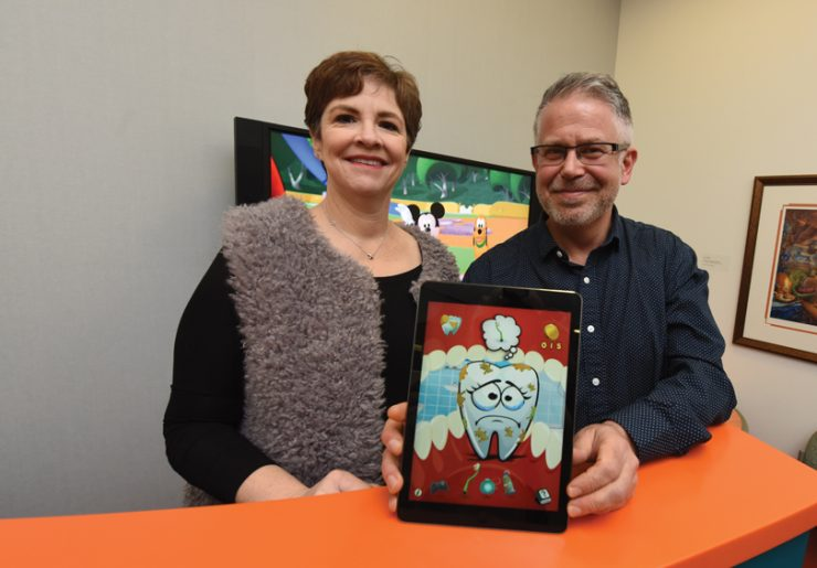 Dr. Tara Schafer and Jeff Mastromonico with app.