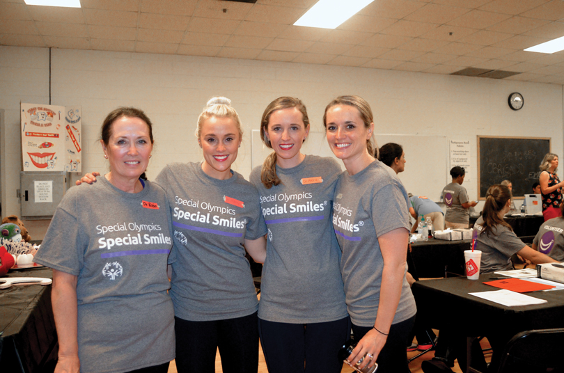 with daughters Stacey Reich Wingad, Alena Reich and Megan Reich Rihan at the Special Olympics.