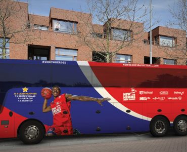 The New Heroes basketball team's bus features Keshun Sherrill (BA '17).