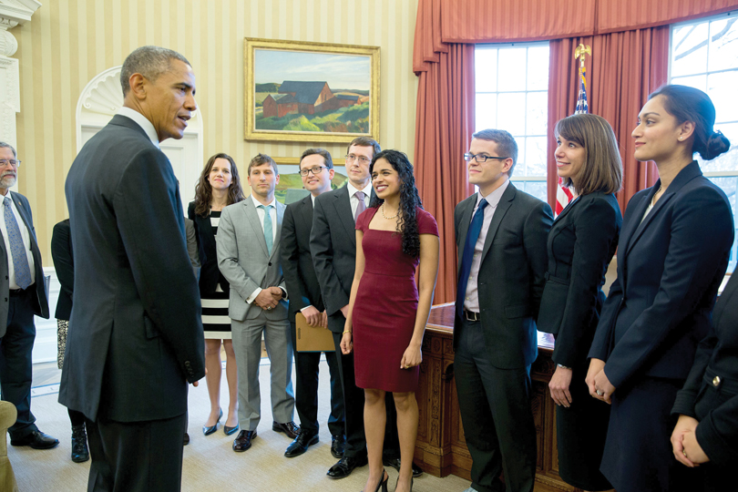 President Barack Obama meets with members of the White House's Social and Behavioral Sciences Team, including Lori Foster on far right, in 2016 in the Oval Office.