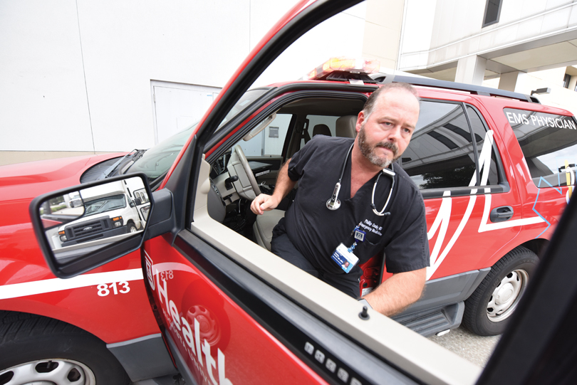 Dr. Philip Coule exits an EMS Physician vehicle.
