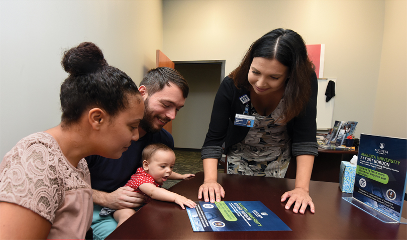 Alejandra Miles, right, meets with Stephanie Ortiz and Edward Fulk Jr. with his daughter Luna. Photo by Phil Jones.