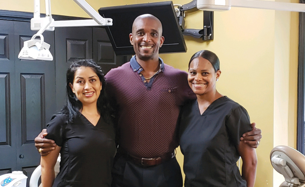 Dr. Edmond Michael Franklin with two of his staff members