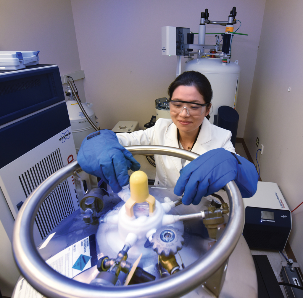 Juan Zou at the Clinical and Biomolecular Analysis Facility. Photo by Phil Jones.
