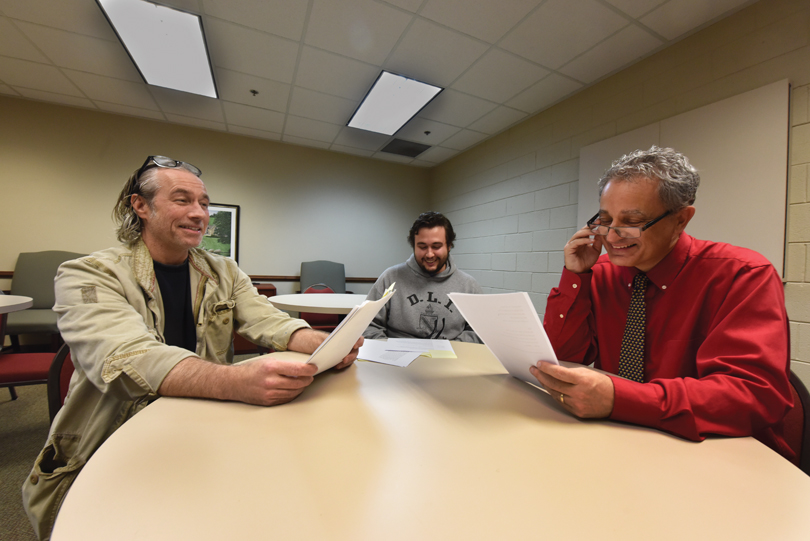 Book writer and director Doug Joiner, left, goes over the script with Mark Swanson and assistant director Benjamin Evans, center.
