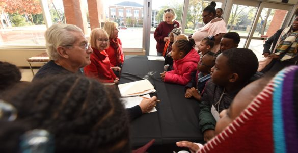 Dr. Paulette Harris, center, welcomes young audience members to Holly and the Snowman in December 2018.