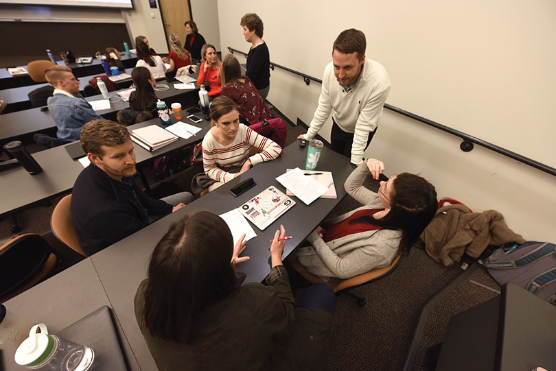 Debra Beazley, Malynda Carruth (DPT, '91) and Wesley Spake (DPT, '11) speak to small groups during a recent class.