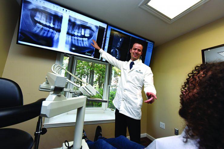 Dentist pointing at x-ray