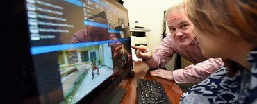 Man pointing at computer monitor