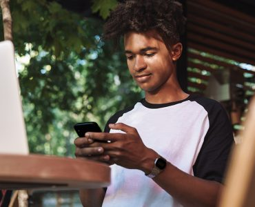 Young man looking at smartphone.