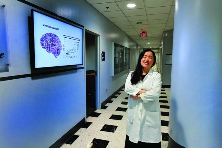 Dr. Xin-Yun Lu looking at camera