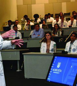 Dr. D. Douglas Miller addresses class
