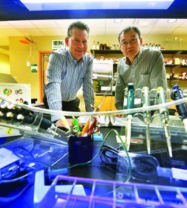 Dr. Joseph Miano and Dr. Lin Gan in lab