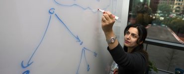 Dr. Hoda Maleki at whiteboard