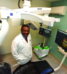 Dr. Emmanuel Ngoh in treatment room