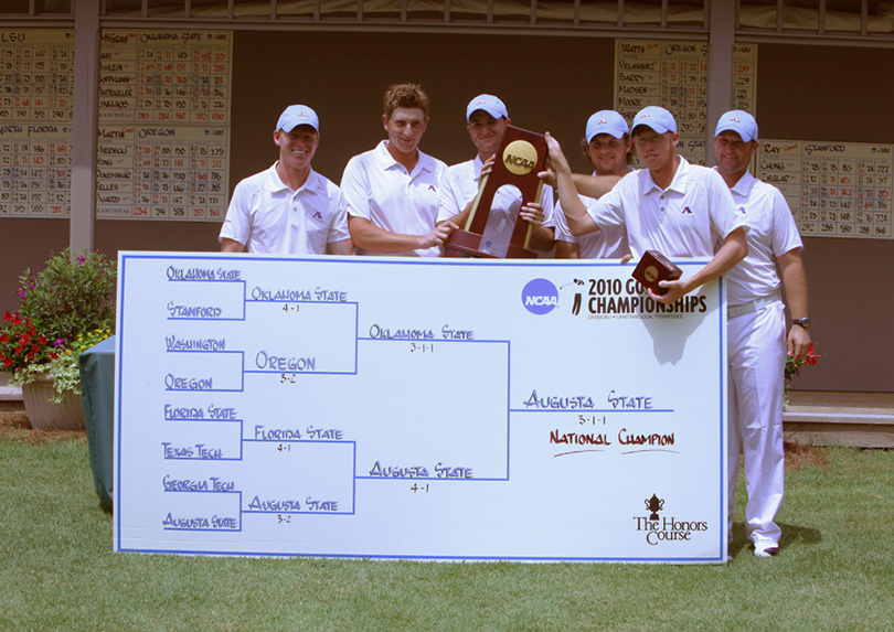 golfers with trophy and scoreboard
