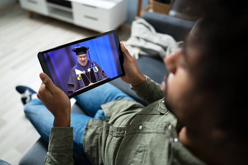 student watching ceremony on tablet