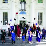 Graduates throwing caps and White House