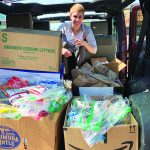 woman with boxes of donations