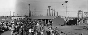 historical photo of workers leaving plant