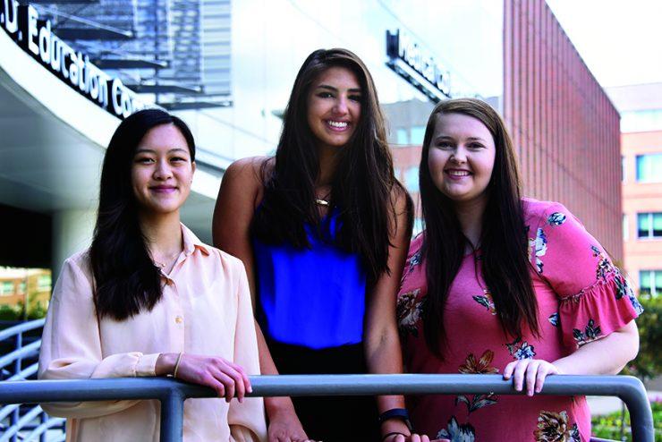 Three dental students