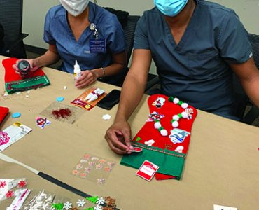 People making holiday stockings