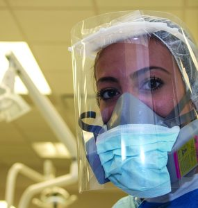 Dentist in personal protective gear due to COVID-19 pandemic