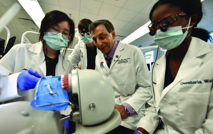 Scientist in lab doing demonstration
