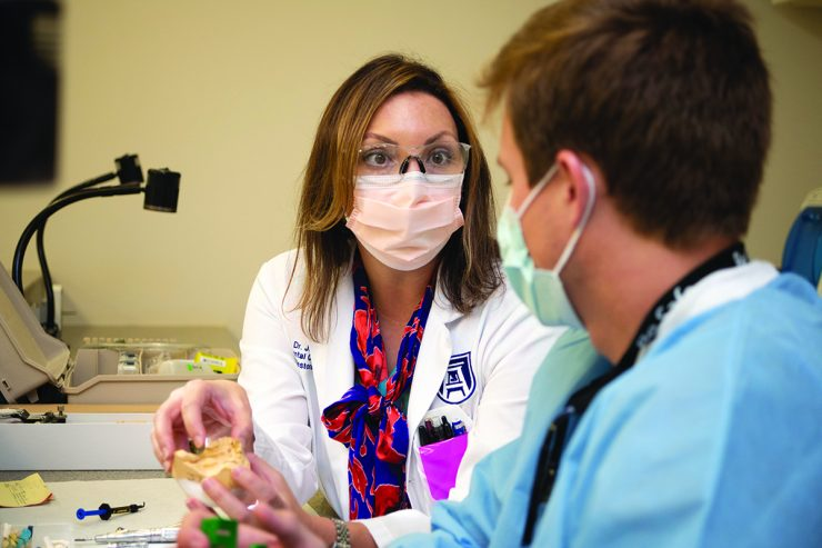 Woman in surgical mask talking in clinic - Dr.Jacqueline Delash