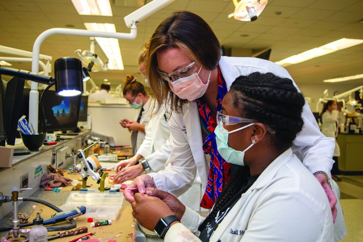 Woman in surgical mask teaching in clinic - Dr.Jacqueline Delash