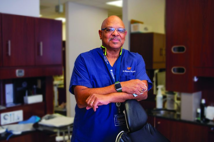 Man named Maurice Lewis smiling in dental clinic