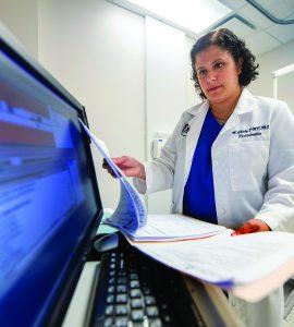 Scientist Mira Ghaly in lab