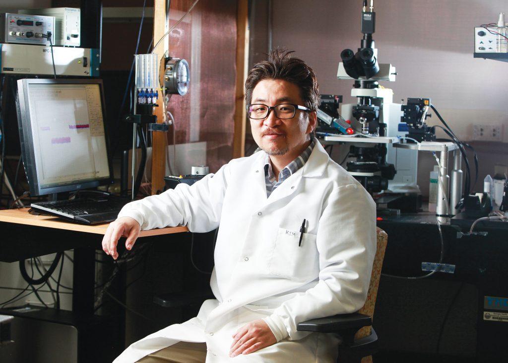 man sitting at lab posing for camera