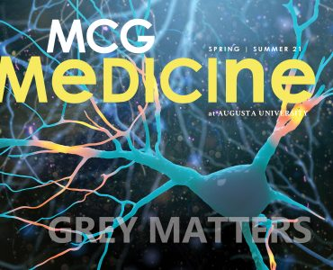 Cover of the MCG Medicine magazine- Spring Summer 2021 edition. Background of neuron
